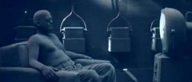 Still from Tool's Stinkfist music video of a man sitting in front of a tv