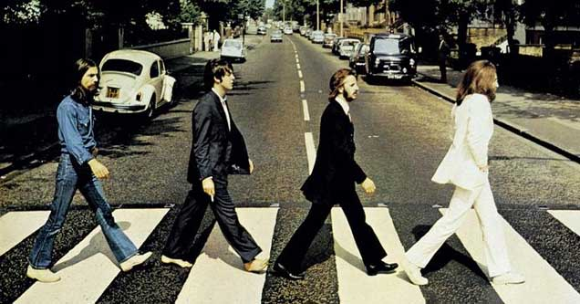 The Beatles crossing Abbey Road, an image which would go on to become iconic in its own right as the cover of their last album