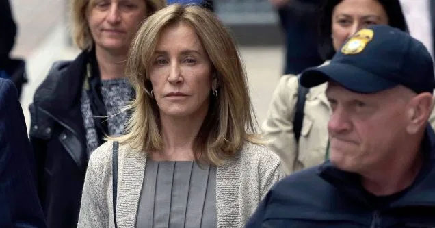 Actress Felicity Huffman with police escort