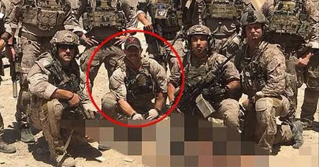 Eddie Gallagher posing with a dead body while stationed in Iraq