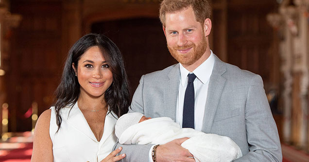 prince harry and meghan markle with their baby