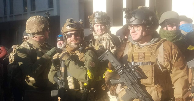 Gun-rights activist dressed in full military clothes protesting in Richmond Virginia