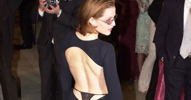 Gillian Anderson is getting pretty horny online and people are loving it - her in a black dress with a thong showing.