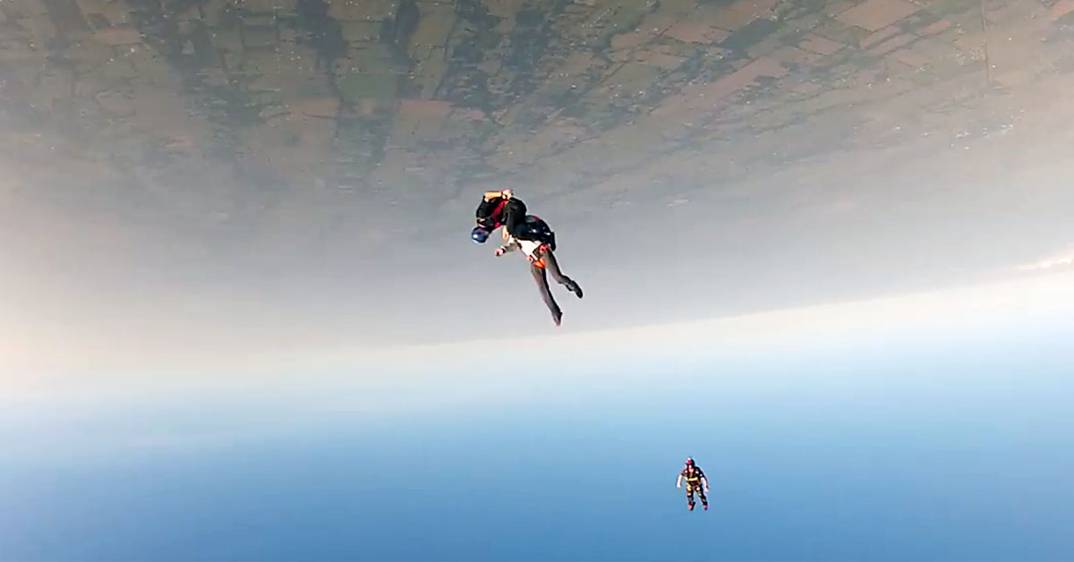 screenshot of helmet cam video of two skydivers colliding mid air