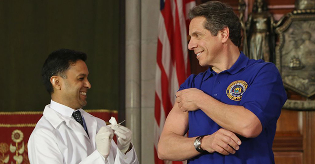 new york governor andrew cuomo getting a shot from a doctor
