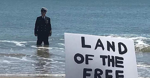 Navy Admiral Standing in the ocean for a protest - land of the free