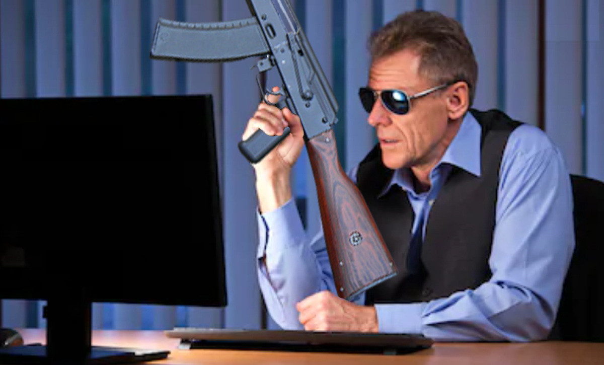 call of duty modern warfare video games pc gaming - guy wearing sunglasses looking at his computer holding an ak-47 rifle