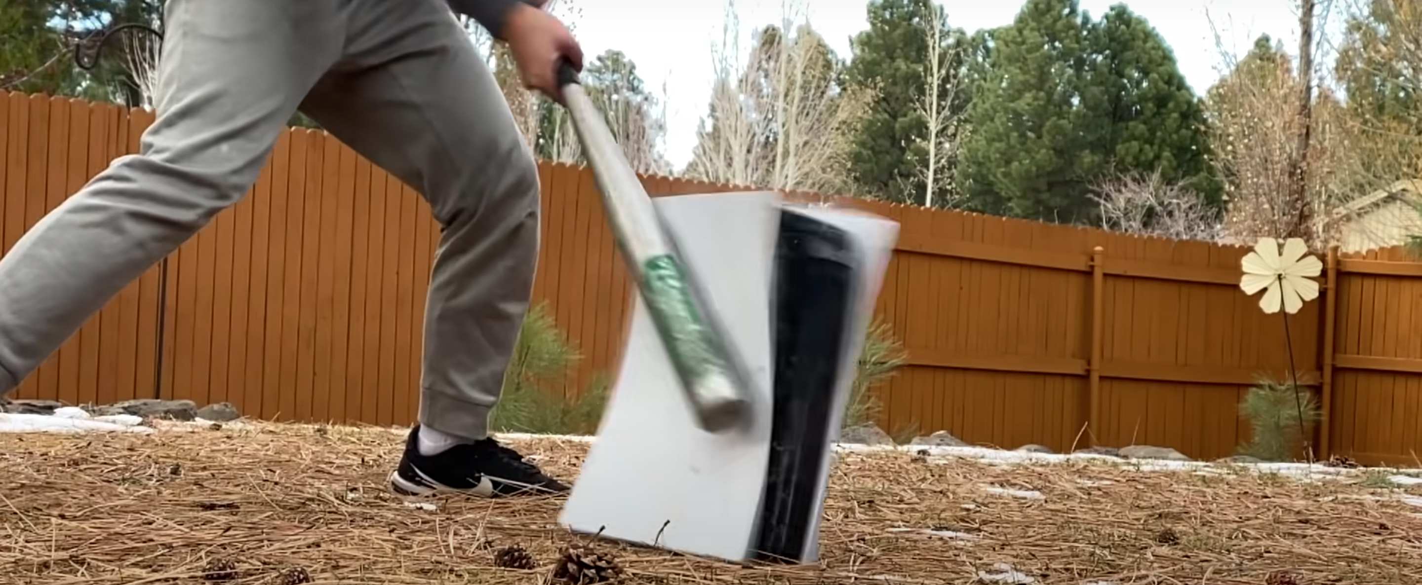 guy smashing a PS5 with baseball bat