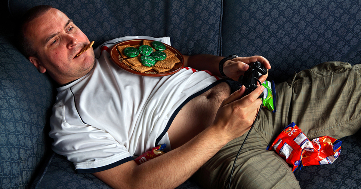 lazy fat guy playing video games