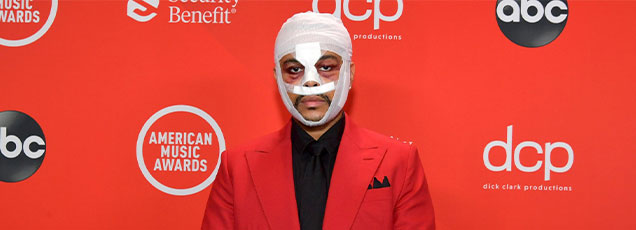 the weekend wearing bandages on his face while walking the AMA red carpet
