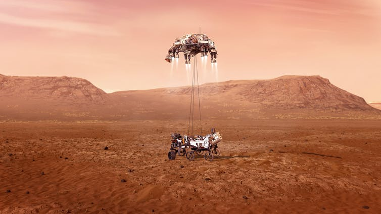 the sky crane delivering the mars rover perseverance 2021