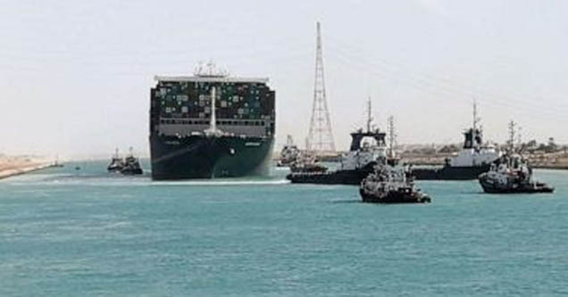 Tugboats accompany newly-freed Ever Given across the Suez Canal