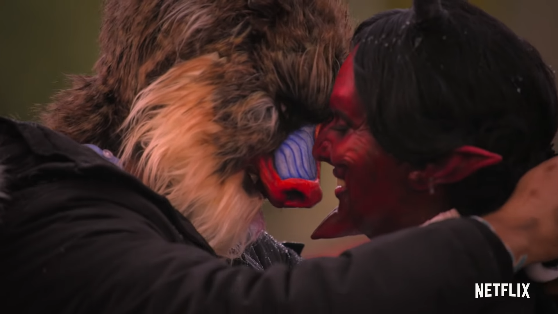 babboon man and devil lady kissing