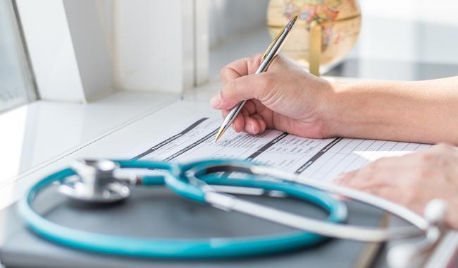 Physician Compensation Under Risk Arrangements: An empirical study and survey