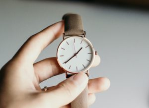 person holding watch