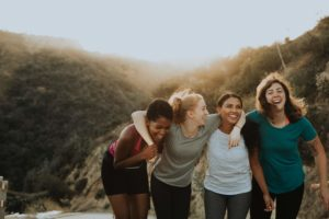 women smiling in nature