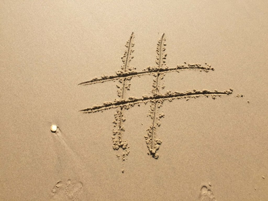 hashtag written in sand