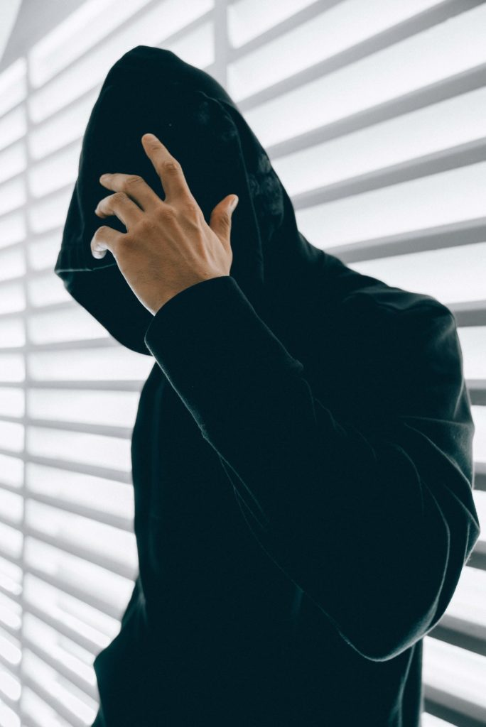 person wearing a black hoodie