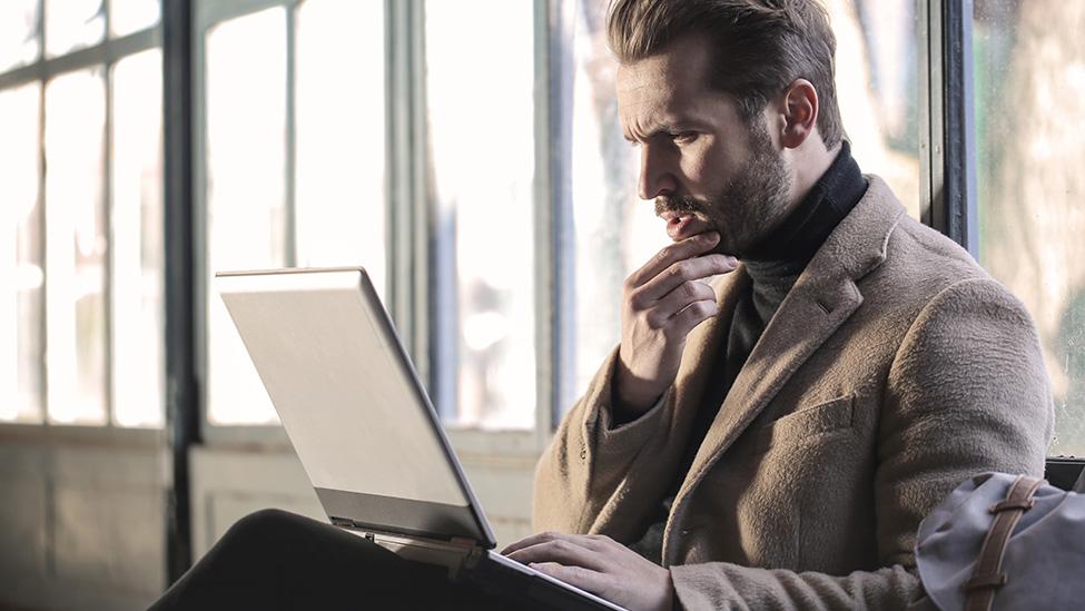 man typing on computer