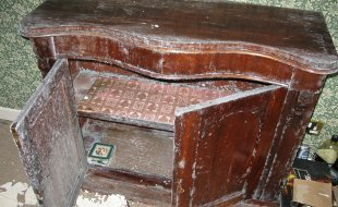 Water & flood damaged cabinet