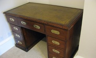 Flood damage desk, needing restoration to the leather as well as polishing
