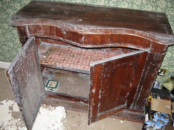 Flood damaged cabinet,