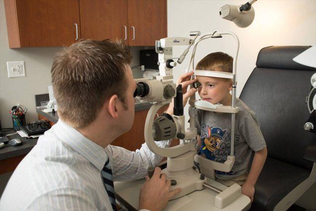 Eye Doctor, little boy in eye exam in Hoffman Estates, IL