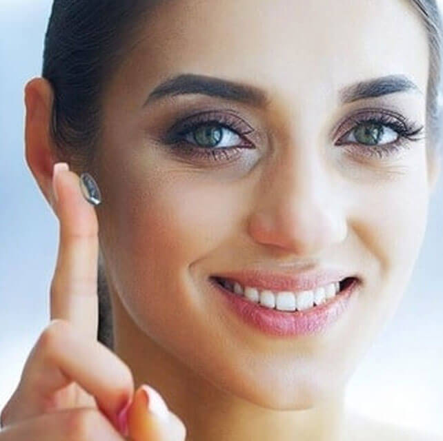 smiling girl wearing black frames