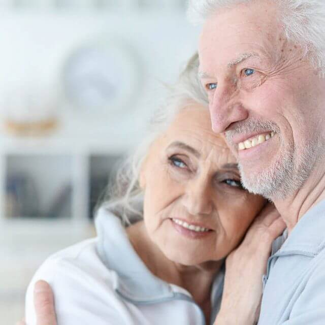 happy couple with low vision treatment