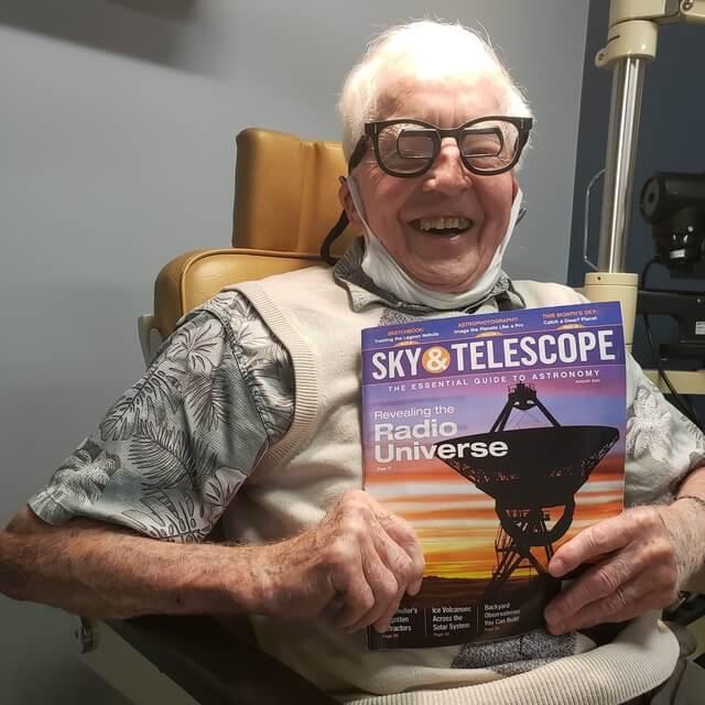 happy senior man wearing low vision eyeglasses