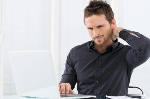 man neck pain in black sleeves