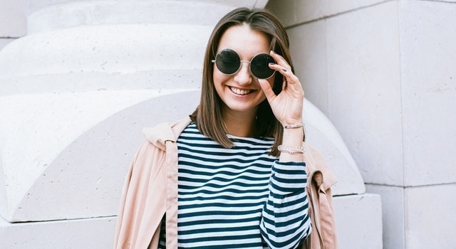 young-woman-wearing-round-sunglasses-640
