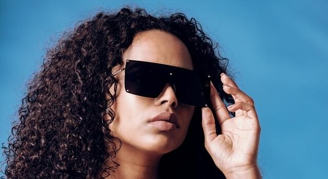 woman wearing protective shield sunglasses 640