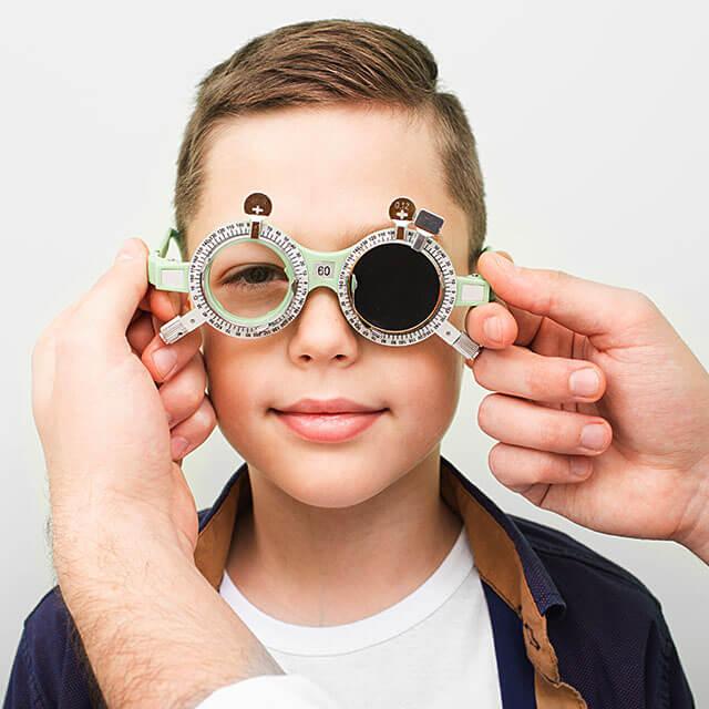 optometrist examining boy 640