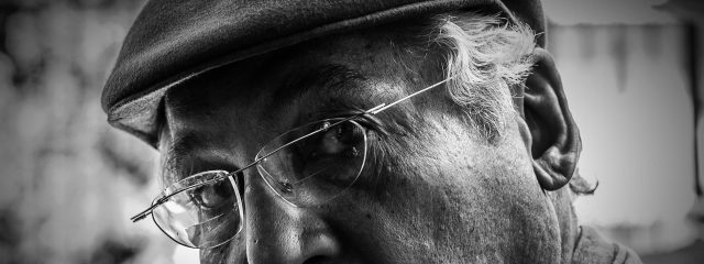 older man with glasses goes for routine glaucoma screening near you