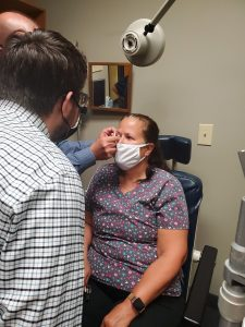Eye Doctor using tear care from to treat dry eye