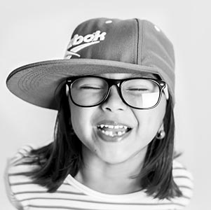 A smiling young lady, Eye Care in Lakeville, MN