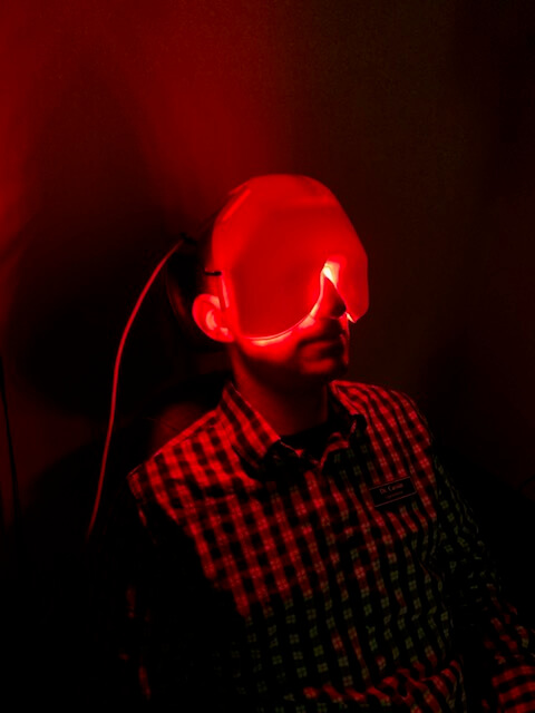 Patient receiving low level light therapy for dry eye