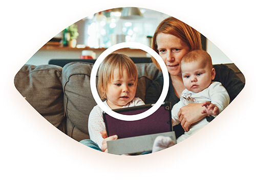 Mother and children reading together