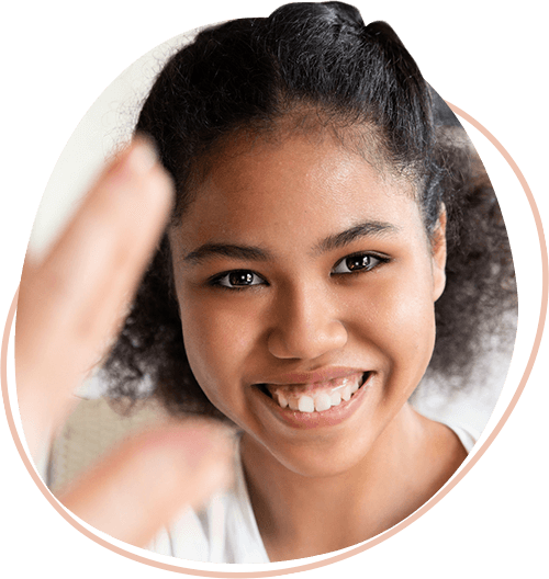 Young-African-American-girl-smiling-widely-at-the-viewer.png