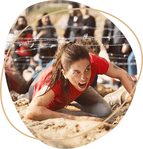 woman-on-the-ground-completing-an-obstacle-course.jpg.png