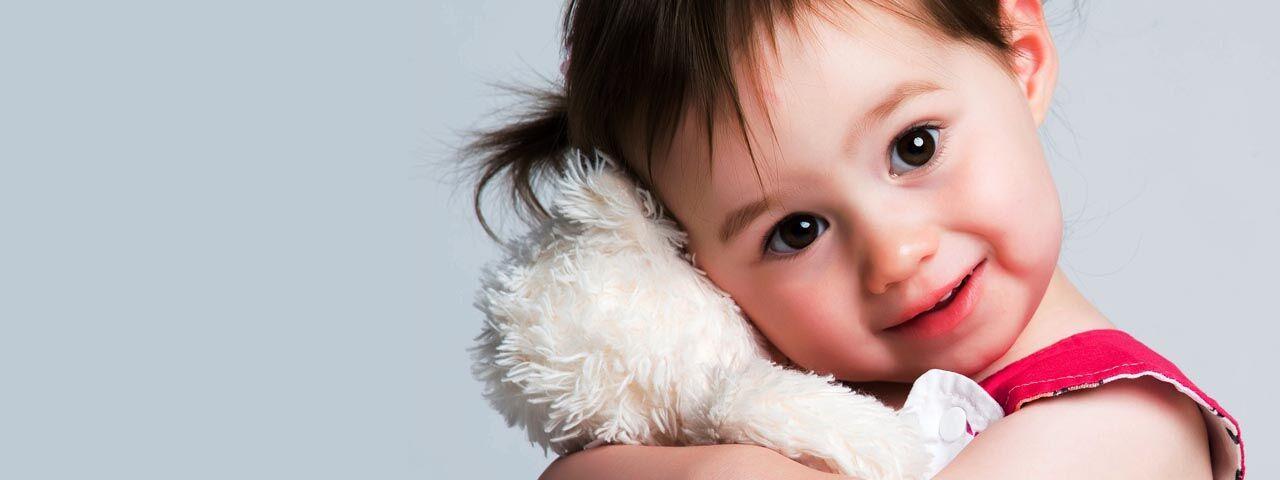 Little girl hugging a stuffed animal in Kissimmee, Florida