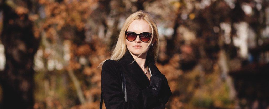 woman wearing sunglasses in autumn in Virginia Beach, VA.