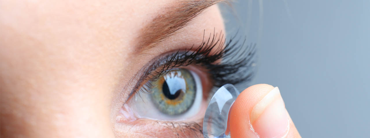 Woman putting contact lens, Eye Care in Fort Collins, CO