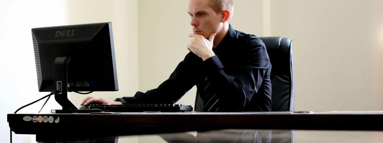 Man working on computer without eyeglasses