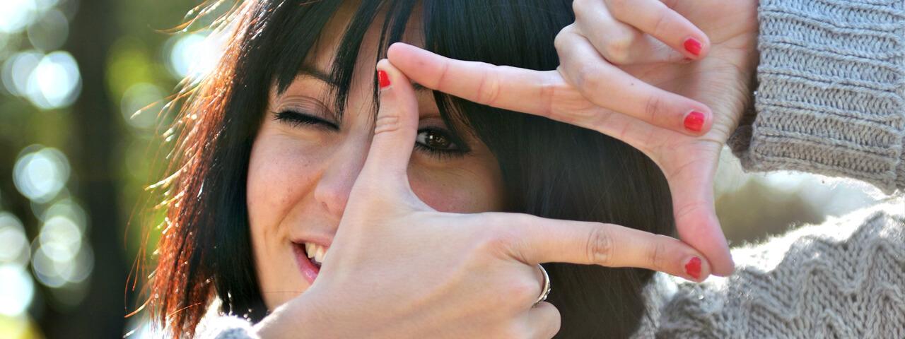 Woman pretending to look through photo lens