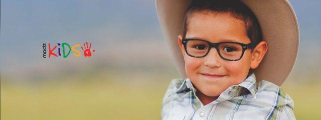 Eye doctor, little boy wearing Modz Kids eyeglasses in Milton, ON
