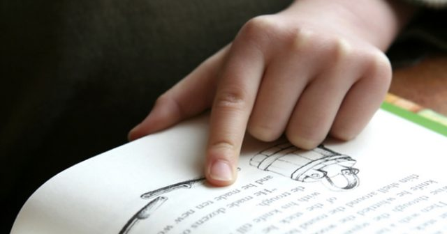 child reading with finger 1200×630