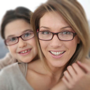Mother and daughter wearing eyeglasses in Los Alamitos, CA