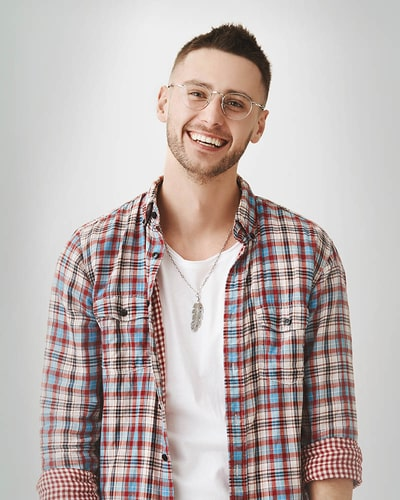 happy man wearing eyeglasses